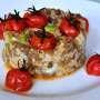 Cous cous integrale di farro con lenticchie, fave, baccalà e pomodori ciliegini arrostiti