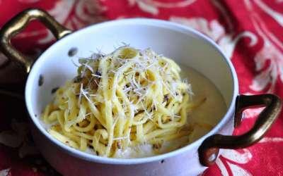 Tajarin al tartufo con fonduta di Parmigiano Reggiano invecchiato
