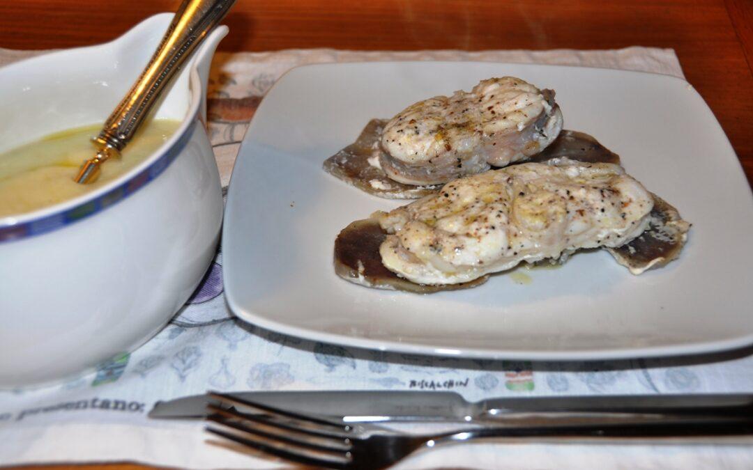 Tranci di rana pescatrice gratinati al forno con patate blu