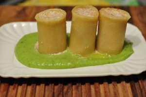 Paccheri ripieni di salsiccia e ricotta su crema di piselli e patate